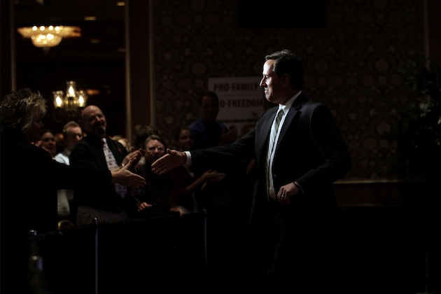 Rick Santorum greets supporters at the Faith and Freedom Coalition Presidential Kick-Off (Jae C. Hong/AP)