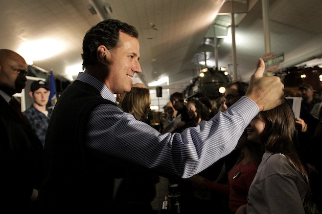 Rick Santorum gives a thumb up while greeting supporters at the National Railroad Museum in Green Bay. (Jae C. Hong/AP)