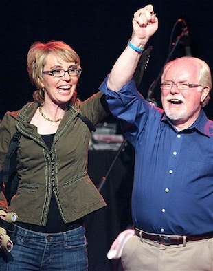 Giffords cheers with Barber at a June 9 event (Mamta Popat/Arizona Daily Star via AP)