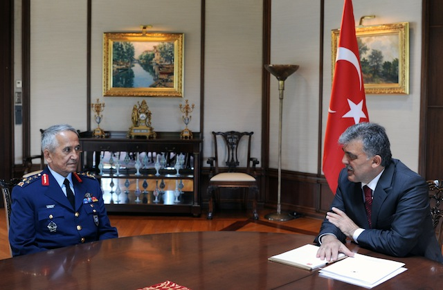 , Turkish President Abdullah Gul, right, meets with Gen. Mehmet Erten, Commander of the Turkish Air Force (Mustafa Oztartan, Turkish Presidency Press Office, HO, via AP)