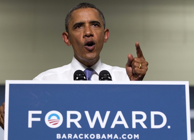 President Barack Obama campaigns in New Hampshire (Carolyn Kaster/AP)