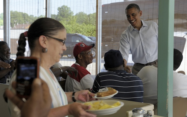 President Barack Obama talks with patrons of Ann's Place in Akron, Ohio. (Susan Walsh/AP)