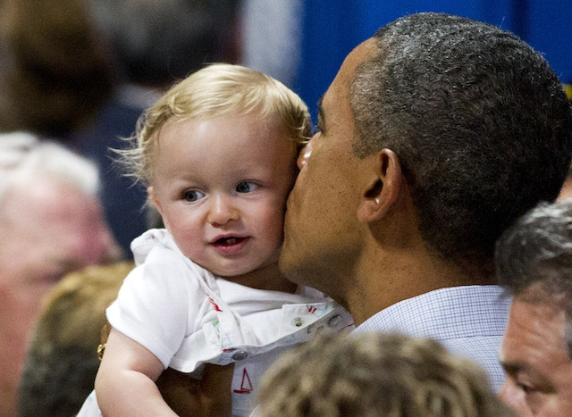 President Barack Obama kisses 9-month-old Nathan Maxwell Johnson of Youngstown, Ohio, at Dobbins Elementary School in Poland, Ohio. (Scott R. Galvin/AP)