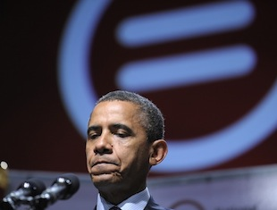 President Barack Obama pauses as he talks about the Aurora, Colo., movie theater shooting as he addresses the National Urban League convention (Susan Walsh/AP)