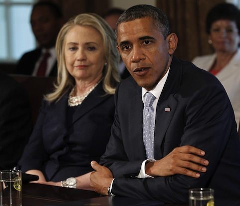 Secretary of State Hillary Rodham Clinton listens at left as President Barack Obama speaks to members of the media during a Cabinet meeting on Thursday. (Pablo Martinez Monsivais/AP)