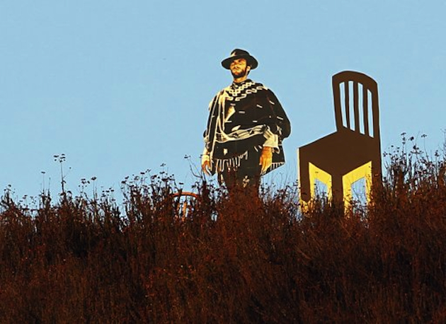 A cardboard cutout of Eastwood and an empty chair along a highway in Glendale, CA (Reed Saxon/AP)
