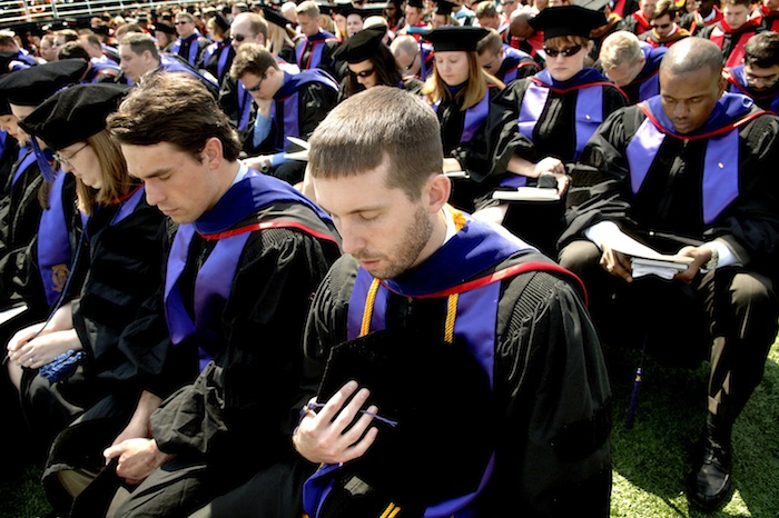 Liberty University students pray during a commencement ceremony. (Jill Nance/AP)