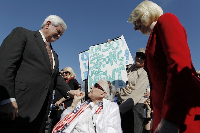 Newt Gingrich, with his wife Callista, meet with Libby Levine, 90, during a campaign event at the The Villages (Matt Rourke/AP))
