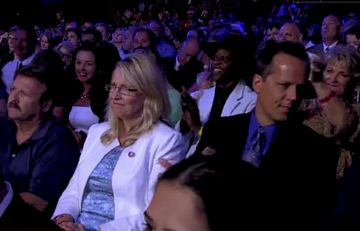 Audience members look on just before Blitzer inquires about letting the uninsured die. (Screenshot: CNN)