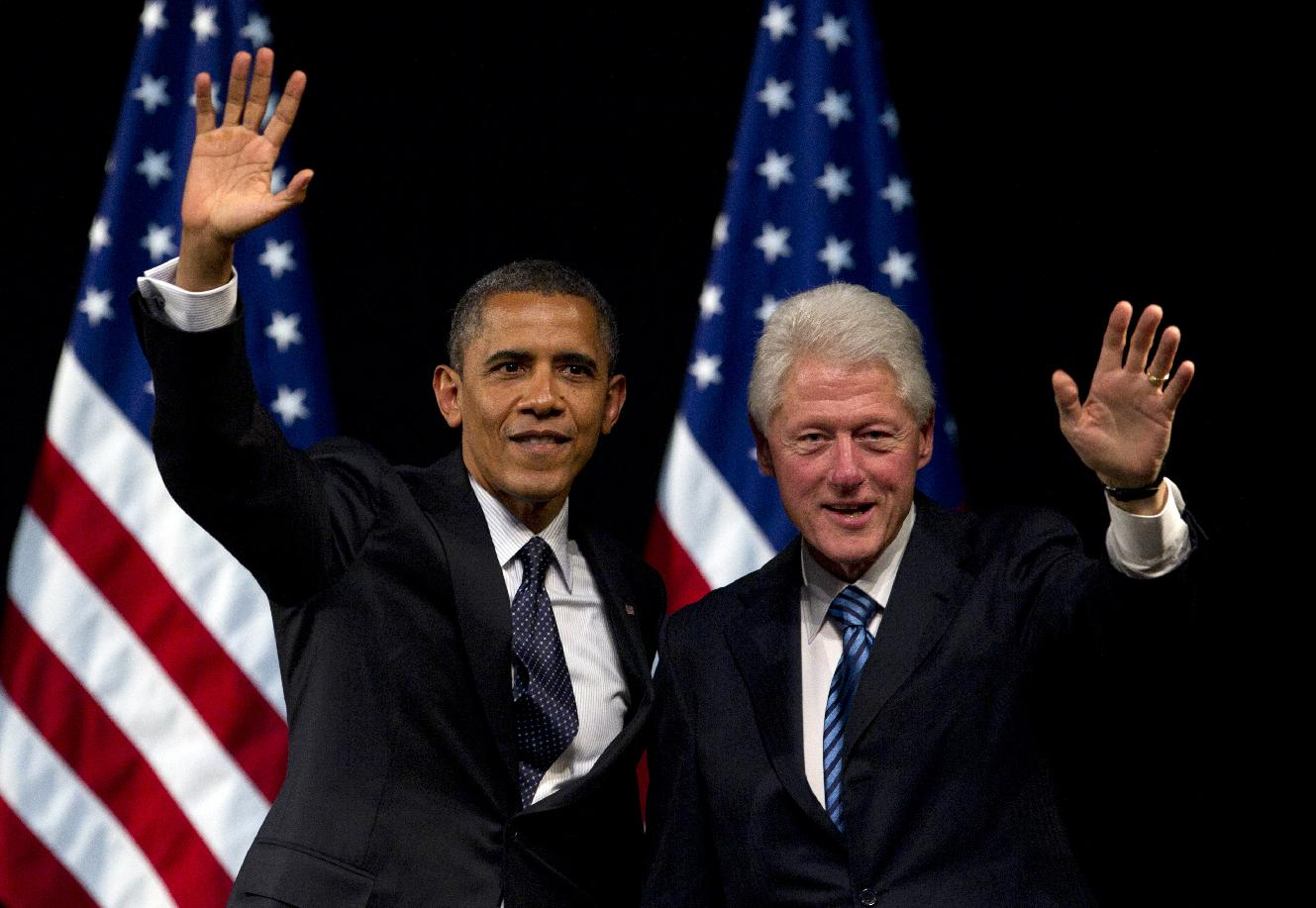 President Barack Obama and former President Bill Clinton campaign together in New York in June. (Carolyn Kaster/AP)