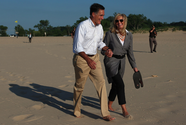 The Romneys walking on the beach near Lake Michigan (Joe Raedle/Getty Images)