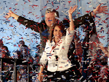 Michele Bachmann and her husband, Marcus, in Ames (Chip Somodevilla/AP)