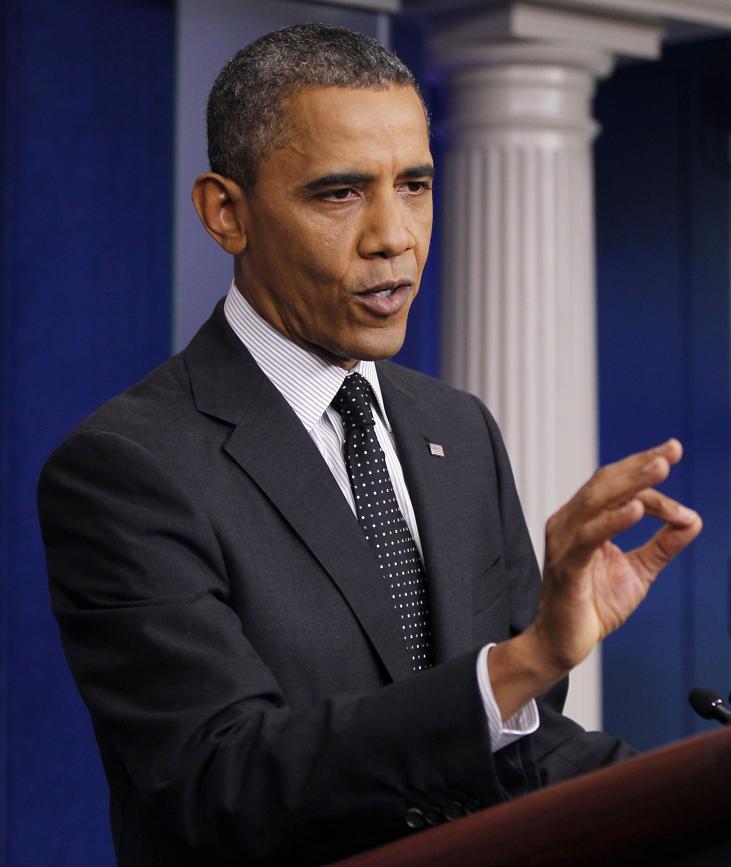 President Barack Obama gestures while speaking in the White House briefing room (Pablo Martinez Monsivais/AP)