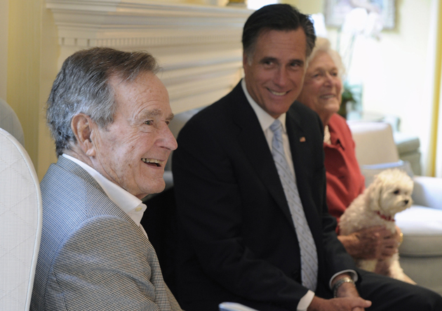 Romney with the Bushes in December (Pat Sullivan/AP)