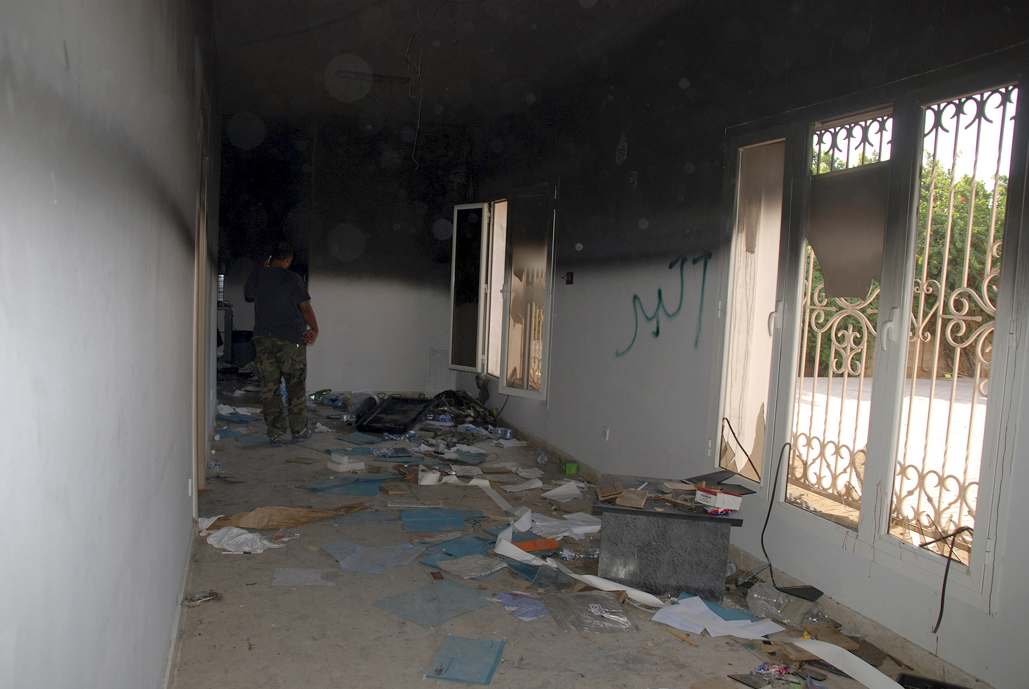 This Sept. 12, 2012, file photo shows a man walking through a room in the gutted U.S. Consulate in Benghazi, Libya. (Ibrahim Alaguri/AP)