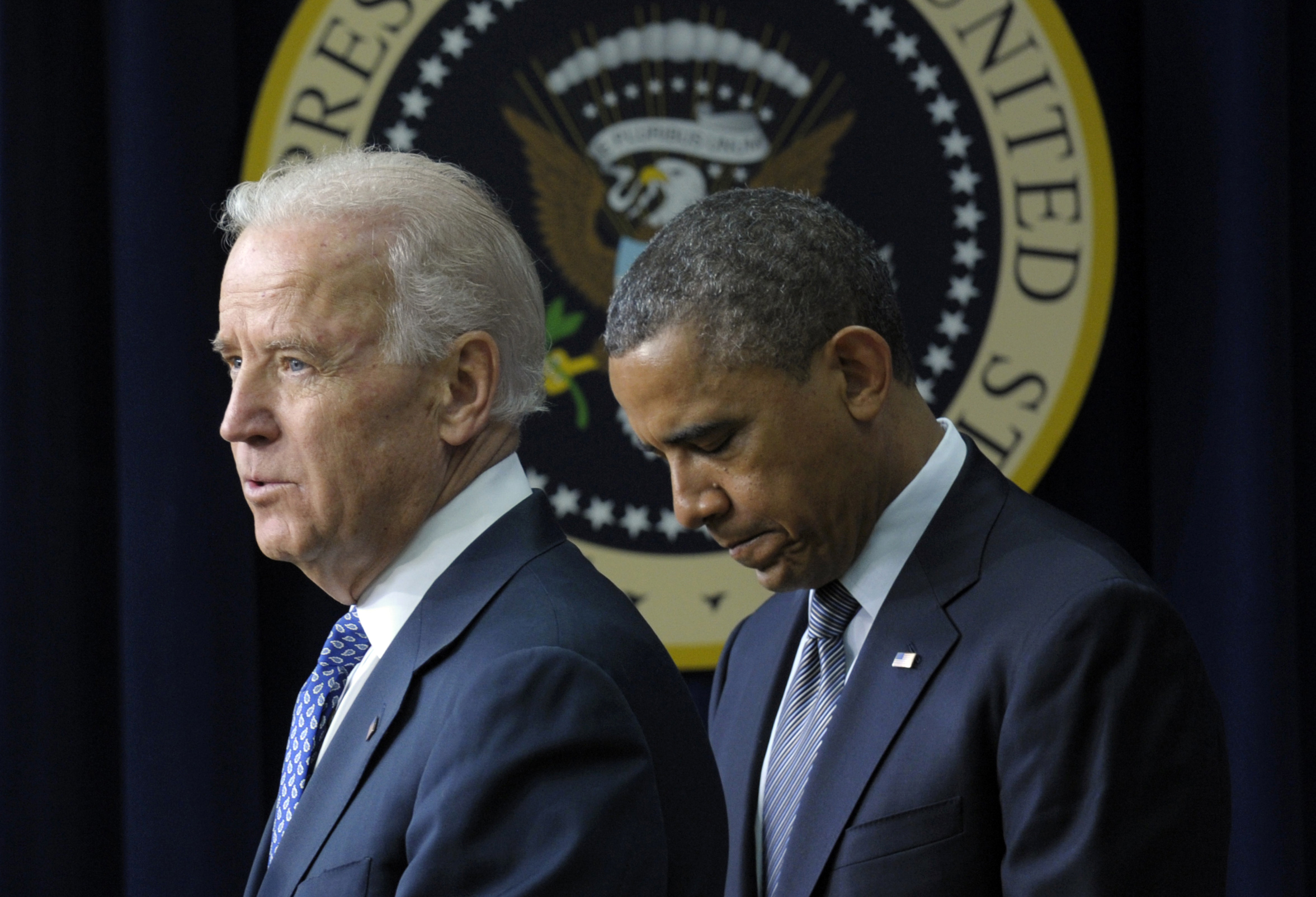 President Barack Obama listens as Vice President Joe Biden speaks at the White House about proposals to reduce gun violence in January. (Susan Walsh/AP)