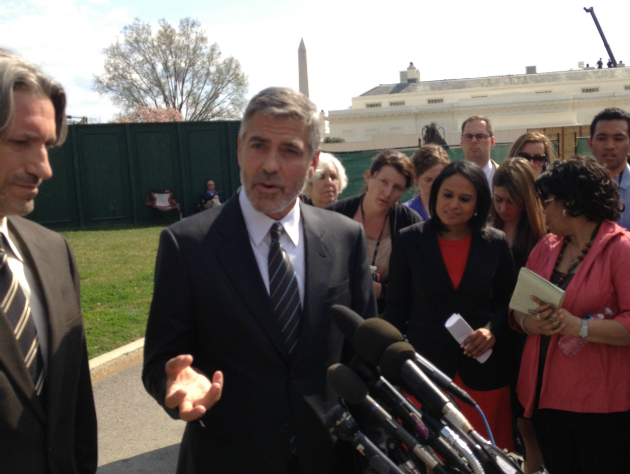 Actor George Clooney talks to reporters at the White House