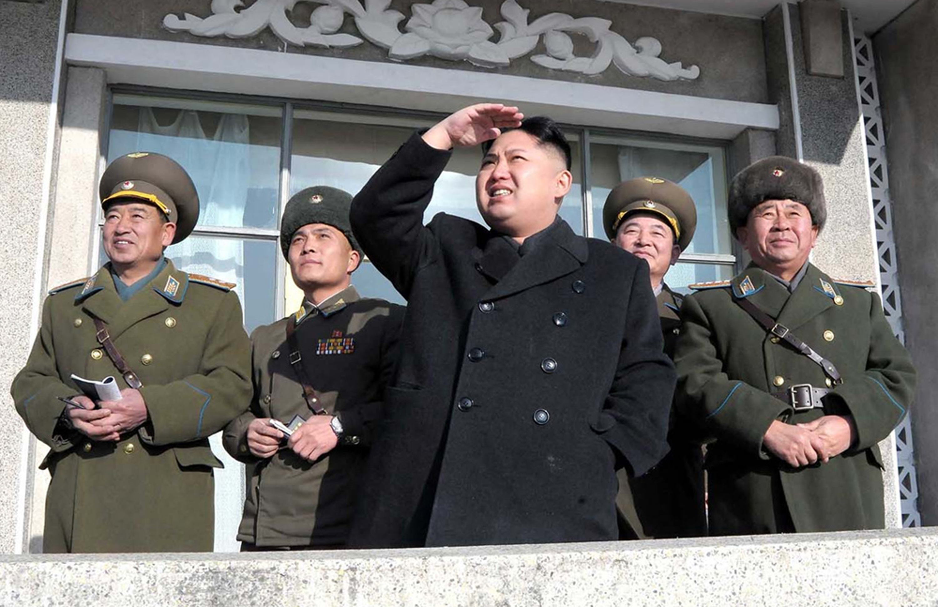 Kim Jong Un, center, inspects an air drill at an undisclosed air base in North Korea on Feb. 1, 2012. (AP Photo/KCNA via KNS)