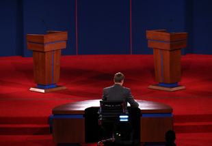 A University of Denver student sits at the debate stage during a rehearsal. (Justin Sullivan/Getty Images)