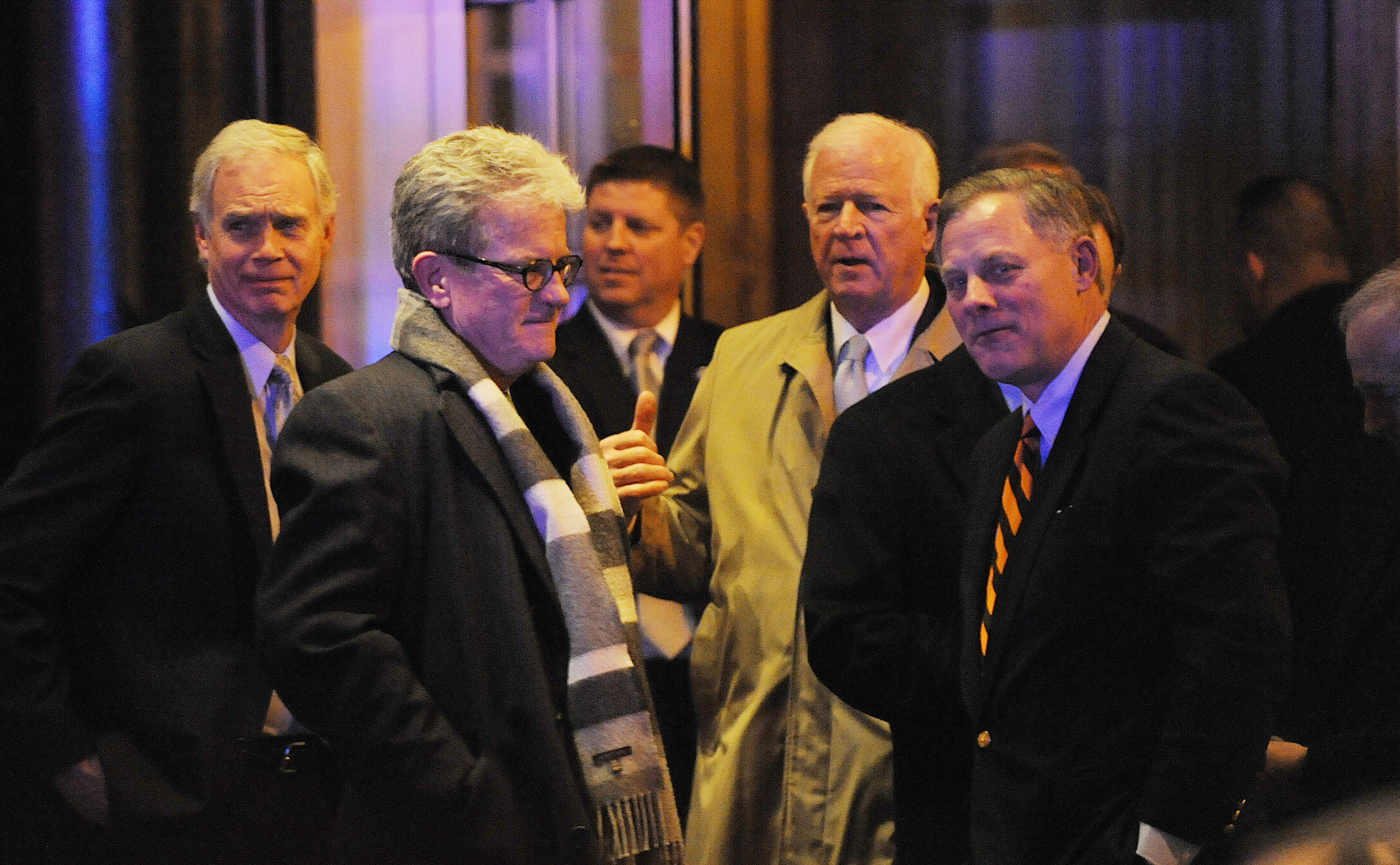 GOP senators, including Ron Johnson, Tom Coburn, Richard Burr and Saxby Chambliss, leave the Jefferson Hotel after dinner with the president on March 6, 2013. (AP/Olivier Douliery, Pool)