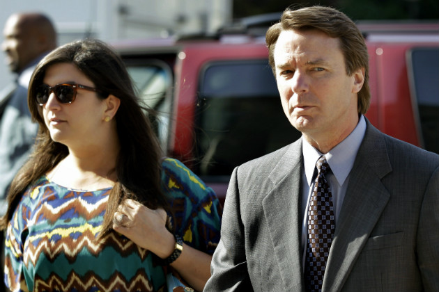 John Edwards arrives at a federal courthouse with his daughter Cate in Greensboro, N.C., May 7, 2012. (Chuck Burton/AP)