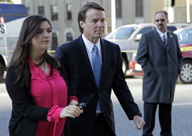 John Edwards arrives at federal court with daughter Cate in Greensboro, N.C., April 23, 2012. (Chuck Burton/AP)