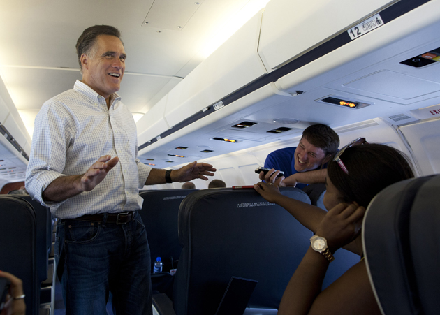Romney on his campaign plane (Evan Vucci/AP)
