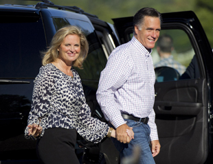 The Romneys head into speech prep in Wolfeboro, NH (Evan Vucci/AP)