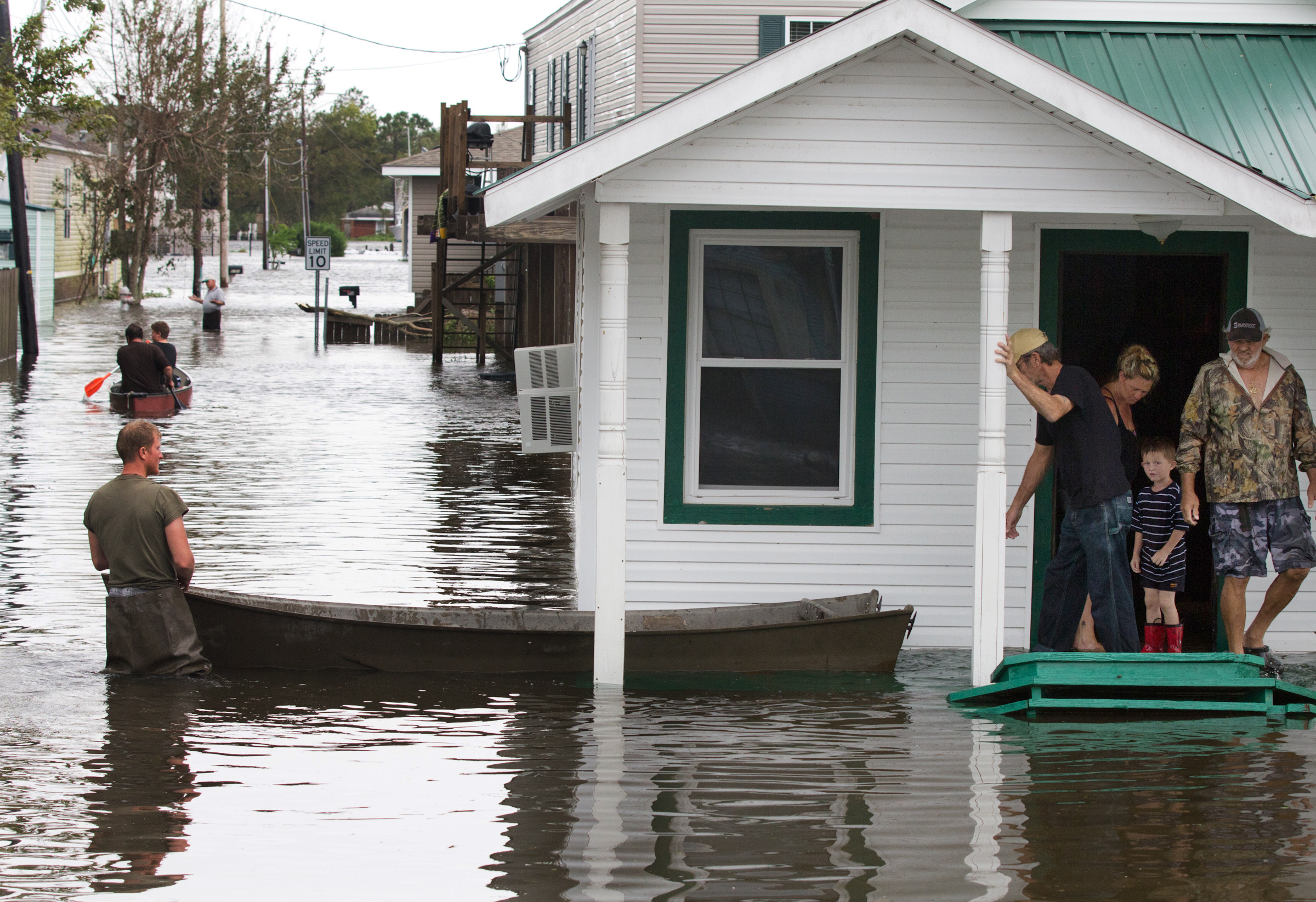 Flooding in Lafitte, La., causes residents to travel by boat on Thursday, Aug. 30, 2012, a day after Hurricane Isaac hit the area near New Orleans. (Erik Schelzig/AP)
