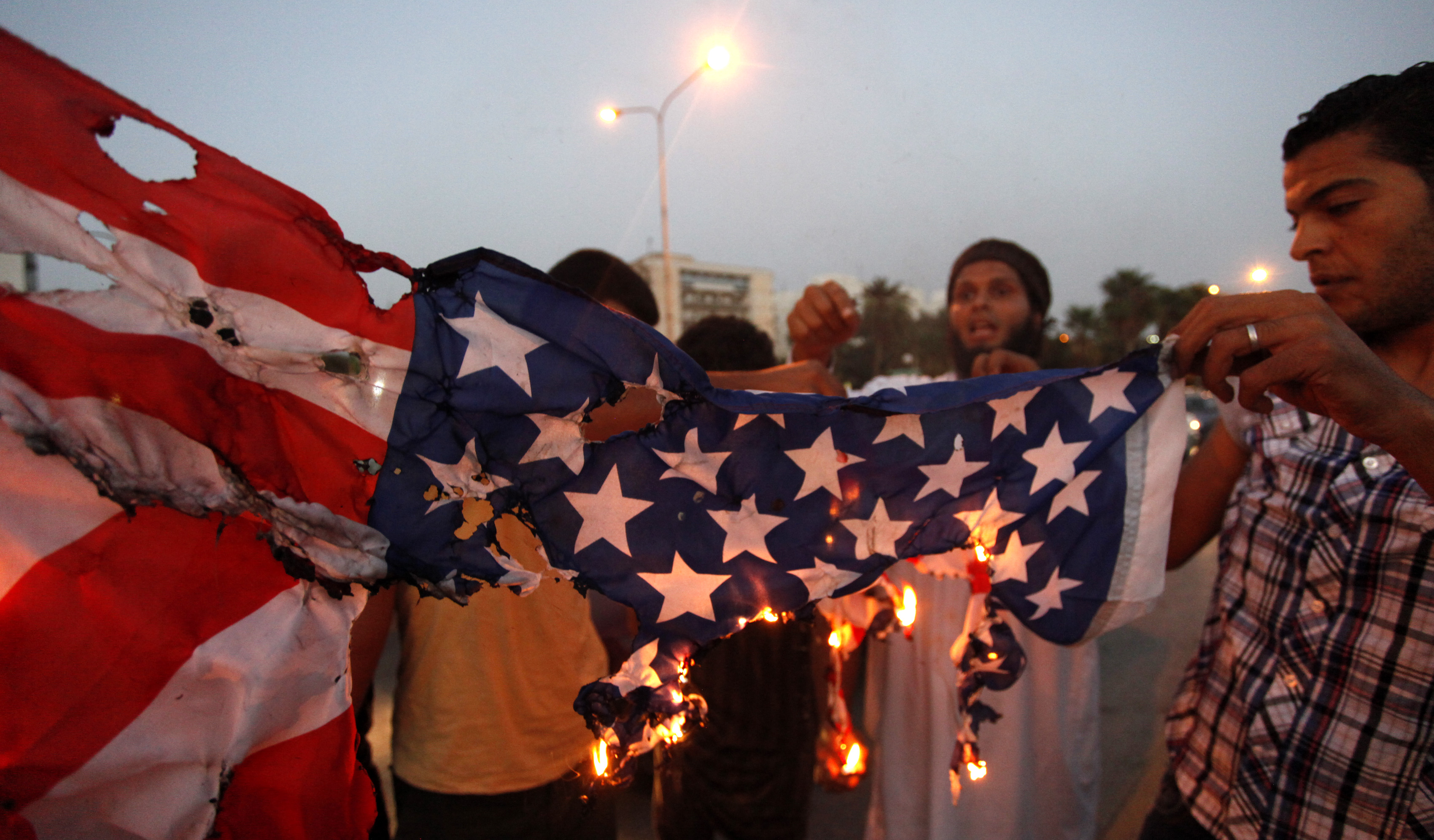 Libyan followers of Ansar al-Shariah Brigades burn the U.S. flag during a protest in Benghazi, Libya, on Friday. (Mohammad Hannon/AP)