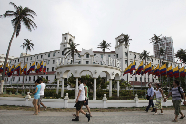 People walk past Hotel El Caribe in Cartagena, Colombia, April 14, 2012. (Fernando Vergara/AP)