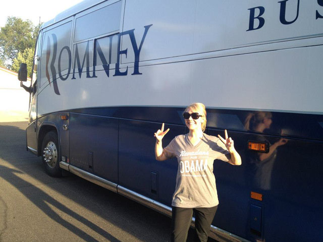 Obama supporter Katie Silva poses in front of Mitt Romney's campaign bus in Reno, Nev. (Katie Silva)