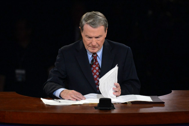 Lehrer looks over his notes before the first presidential debate, Oct. 3, 2012, in Denver. (AP/Pool)