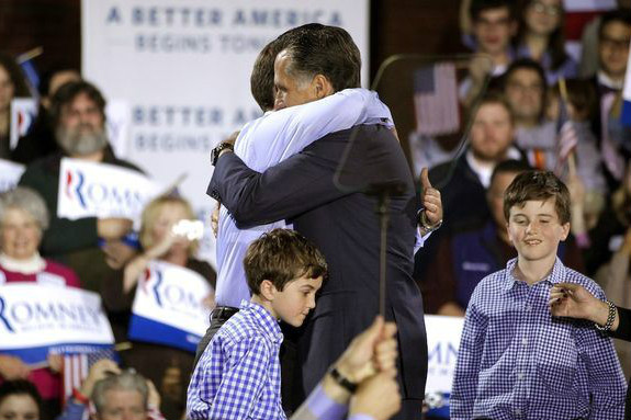 Mitt Romney hugs his son, Tagg, at a campaign stop. (AP/File)
