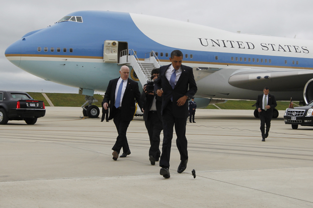 Obama drops his Blackberry outside Air Force One  (Charles Dharapak/AP)