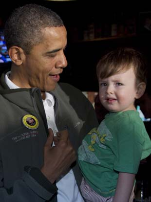 President Barack Obama holds Cooper Coleman, 21 months, as he celebrates St. Patrick's Day in Washington.(Carolyn Kaster/AP)