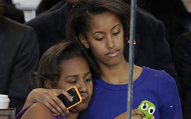 Sasha and Malia Obama at the Inaugural parade (AP/Gerald Herbert)