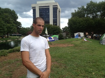 Protester John Harrelson in front of Charlotte's Occupy encampment. (Goodwin/Yahoo)