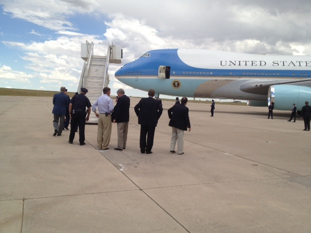 Aurora officials wait for President Obama to exit Air Force One on Sunday. (Liz Goodwin/Yahoo)