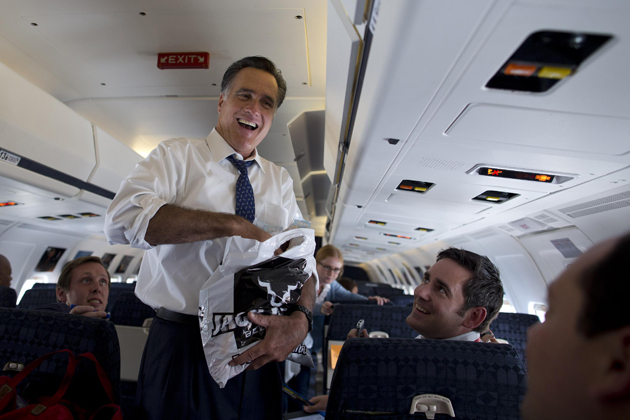 Mitt Romney on his campaign plane Friday (Evan Vucci/AP)
