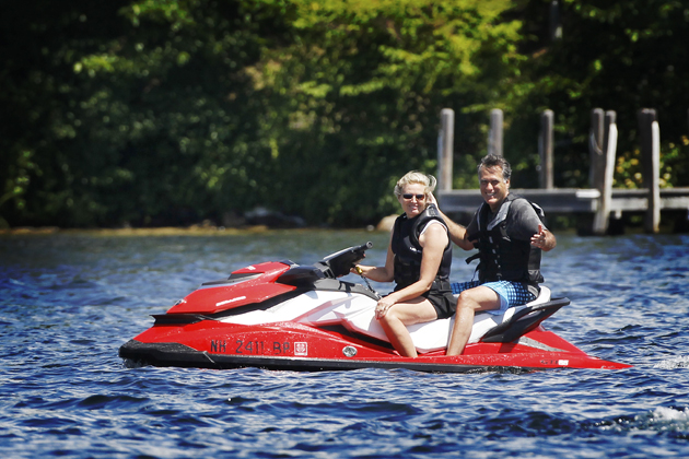 Ann and Mitt Romney on a jet ski in New Hampshire (Charles Dharapak/AP)