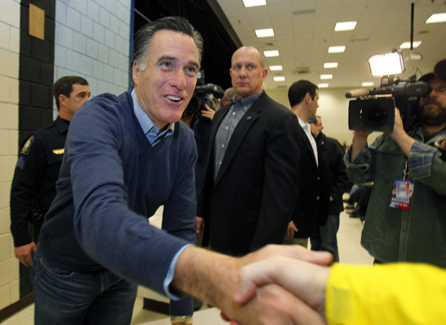 Romney visits a caucus site in Maine Saturday (Robert F. Bukaty/AP)