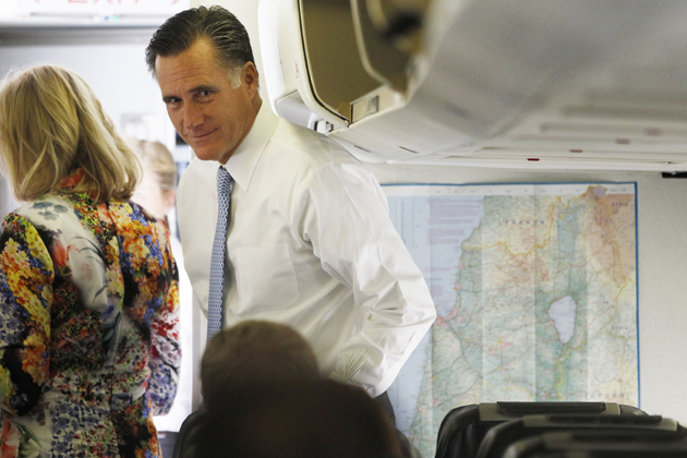 Romney stands near a map of Israel on his campaign plane en route to Poland. (Charles Dharapak/AP)