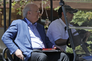 Rove at the Romney retreat (Charles Dharapak/AP)