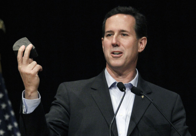 Santorum holds a piece of shale as he speaks at the Gulf Coast Energy Summit in Biloxi, March 12, 2012. (AP/Rogelio Solis)