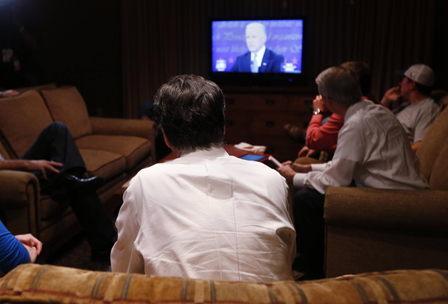 Romney watching the VP debate (Shannon Stapleton/Reuters)