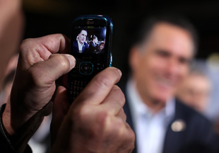Romney, viewed through a supporter's cell phone screen in Ohio (Justin Sullivan/Getty Images)