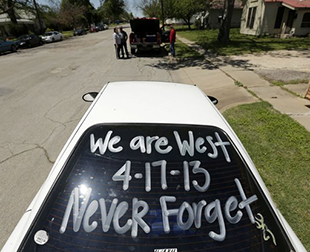 A memorial in a car window in West, Texas (Charlie Riedel/AP)