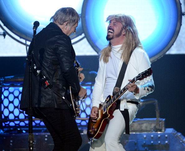 Dave Grohl, in wig, jams with Rush's Alex Lifeson [Kevin Winter/Getty Images]