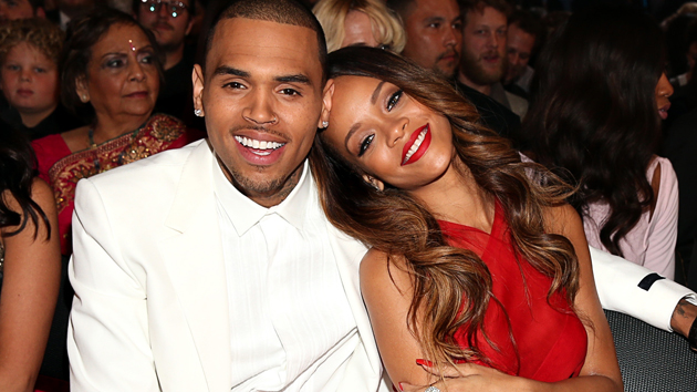 Chris Brown and Rihanna sit together at Sunday's Grammy Awards (photo: Getty)